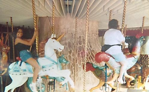 Dena's sister riding the carousel in the Magic Kingdom